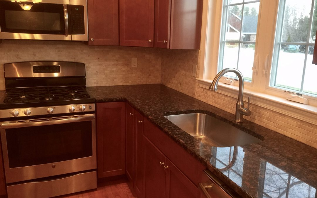 Tan Brown granite counter top with a broken seam and falling sink ...